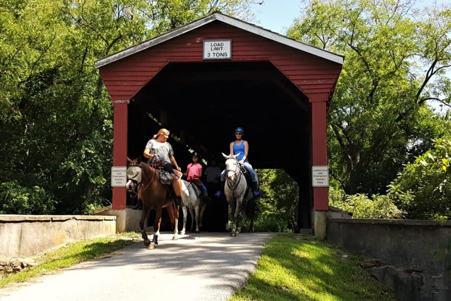 Horseback riding covered bridge